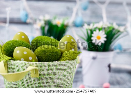 Easter. Painted Eggs on Easter table. Easter Egg in the Basket. Easter Decoration - stock photo