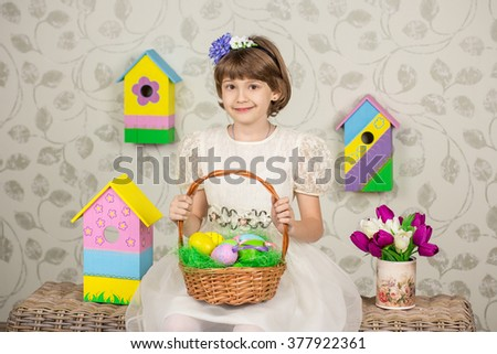 Easter photo.Cute girl with autism celebrating Easter, sitting on chair with handmade decorations. - stock photo