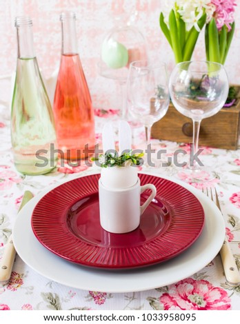 Easter place setting with easter bunny on a plate.