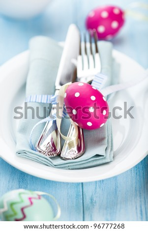 Easter place setting with polka dotted easter eggs - stock photo