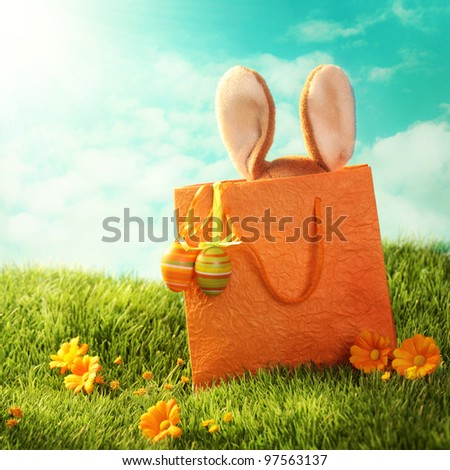 Easter present with rabbit and easter eggs - stock photo