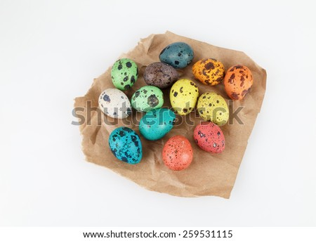 Easter quail eggs on a piece of wrapping paper. Top view. - stock photo