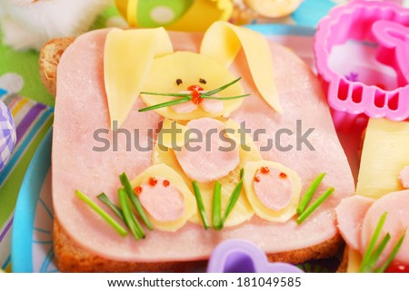 easter sandwich with funny bunny made from ham,cheese and chives for kids - stock photo