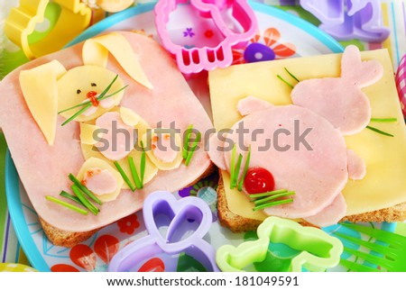 easter sandwiches with funny bunny made from ham,cheese and chives for kids - stock photo