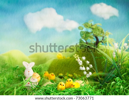 Easter scene with chicks and bunny in the spring meadow.