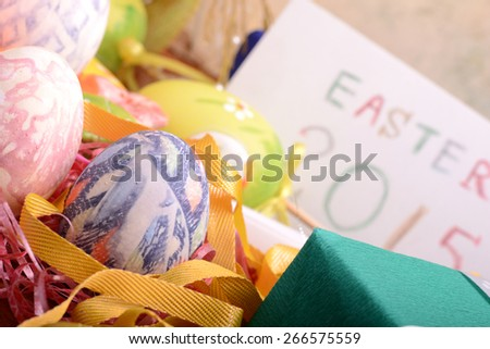 Easter setting with gift box and spring decoration - stock photo