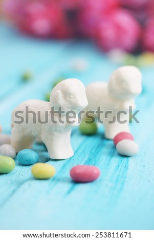 Easter  still life, lamb of white chocolate and candy - stock photo