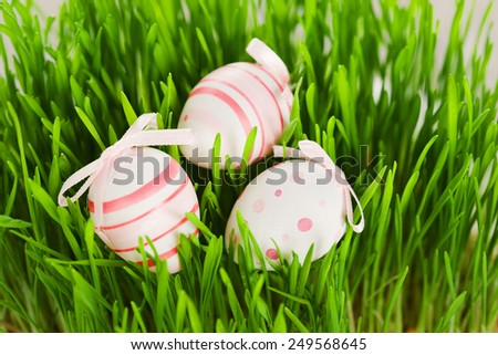 Easter still life of decorative eggs and green grass, selective focus - stock photo