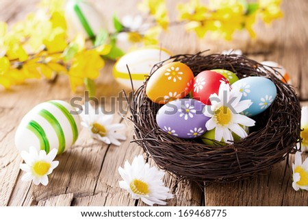 Easter still life with traditional decorative colored eggs in nest - stock photo