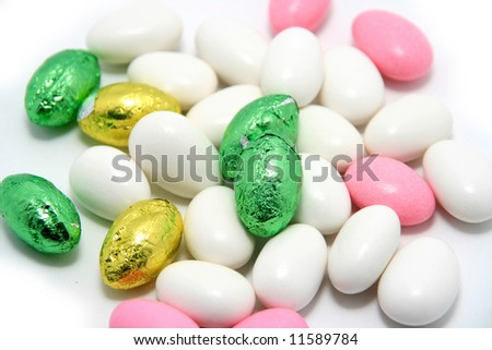easter sugar almonds and chocolate eggs - stock photo