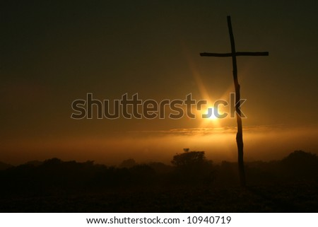 Easter sunday mornig with empty cross - stock photo
