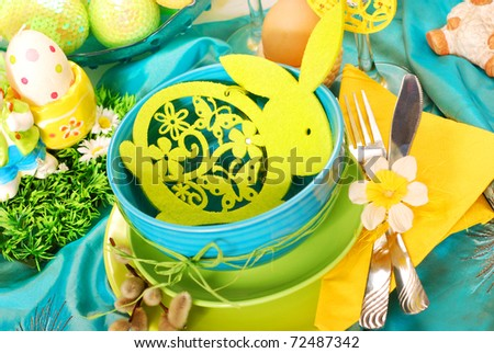 easter table decoration with felt rabbit in bowl in turquoise,green and yellow colors