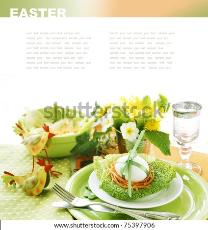 Easter table setting in green and orange tones - stock photo