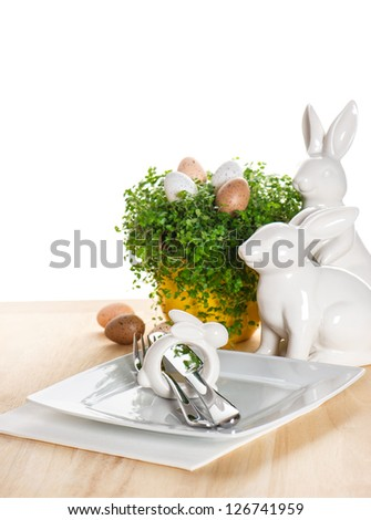 easter table setting with bunny and eggs decoration on white background - stock photo