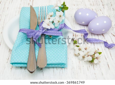 easter table setting with cherry blossoms  on a old wooden background - stock photo