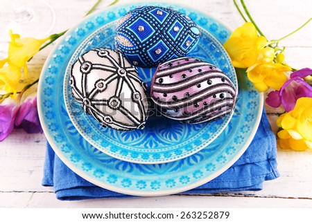 Easter table setting with Easter eggs close up - stock photo