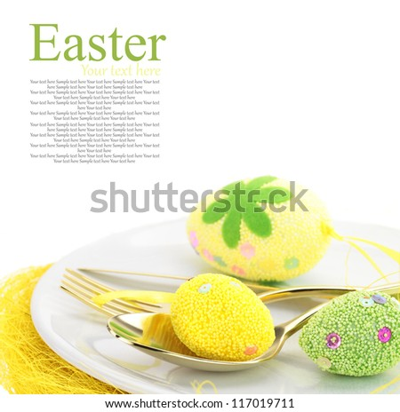 Easter table setting with eggs and cutlery - stock photo