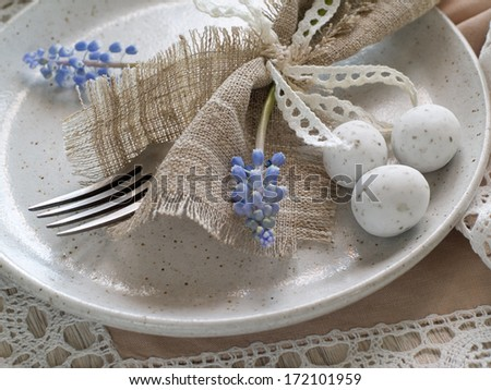 Easter table setting with hyacinth and cutlery, selective focus - stock photo