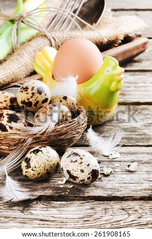 Easter table setting with quail eggs  - stock photo