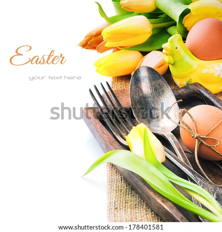 Easter table setting with yellow tulips  - stock photo