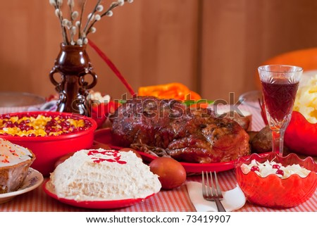 Easter table with celebrate cake  and other meal - stock photo