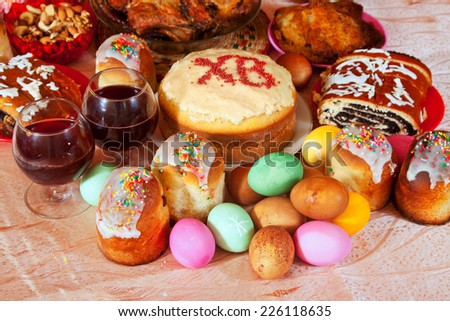Easter table with celebrate cakes  and other meal - stock photo