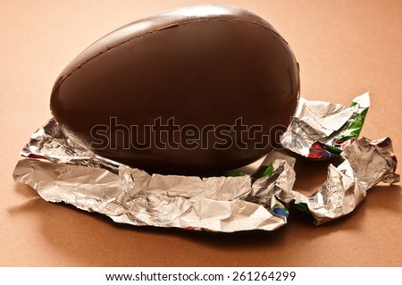 Easter traditional chocolate egg unwrapped - stock photo
