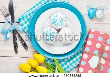 Easter with yellow tulips, gift box and traditional cakes. Top view  - stock photo
