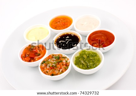 eastern cuisine - several sauceboats with different sauces and seasonings - stock photo