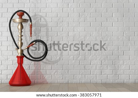 Eastern Glass Hookah in front of brick wall - stock photo