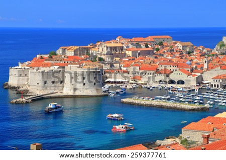 Eastern harbor of Dubrovnik and strong fortified walls in sunny day, Croatia