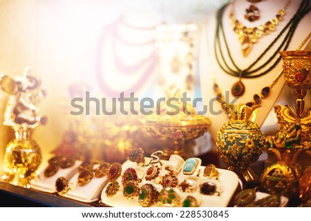 Eastern jewelry market with rings, necklaces and traditional souvenirs. Toned with warm colors. Selective focus. - stock photo