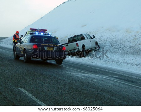 EASTERN OREGON - DEC 11 - State Police assist after traffic accident on icy highway,  on Dec 11, 2010 in Eastern Oregon - stock photo
