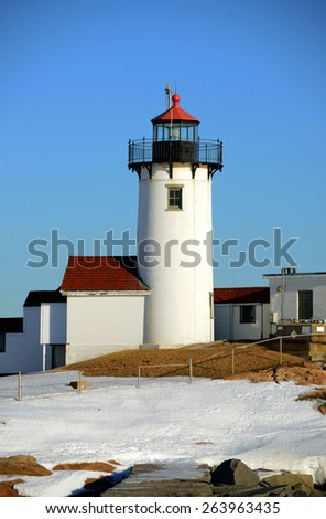 Eastern Point Lighthouse in winter, Cape Ann, northeastern Massachusetts, USA. This historic lighthouse was built in 1832 on the Gloucester Harbor entrance. - stock photo