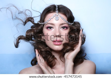 Eastern queen. Fashion model style with make up. Diadem
