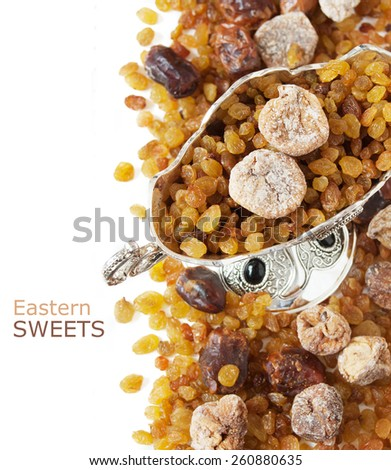 Eastern sweet (still life with nuts, candy, metal vase and date isolated on white background) - stock photo