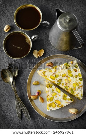 eastern traditional Pistachios dessert on gray background. Selective focus - stock photo