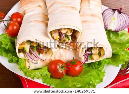 Eastern traditional shawarma on plate with vegetables