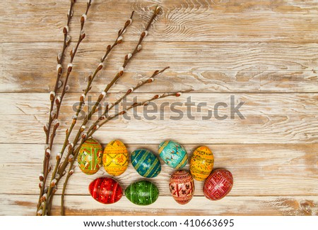 easters spring shabby wooden background.Blank, greeting easter card with easter eggs and catkins - stock photo