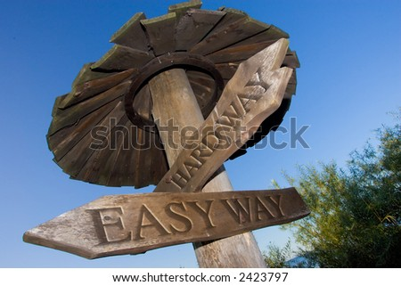 Easy and hard way road sign - stock photo