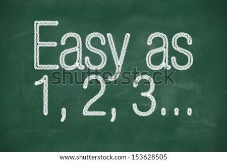 Easy as 1 2 3 phrase written on a chalkboard - stock photo