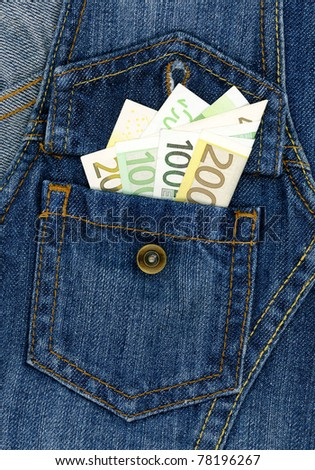 Easy money concept - closeup of many banknotes in blue jeans pocket - stock photo