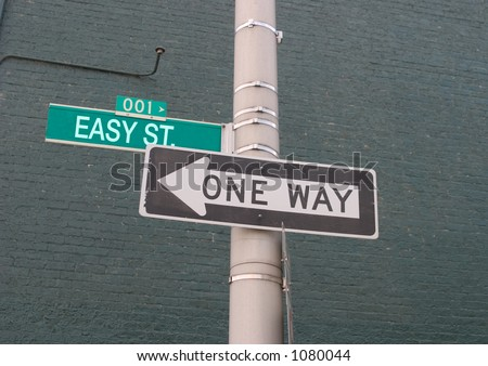 easy street road sign next to a one way road sign - stock photo