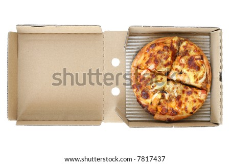 Easy take away pizza still in disposable card board box - stock photo