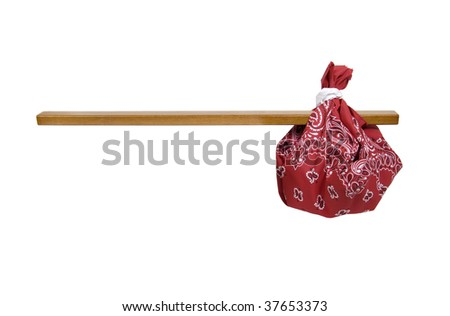 Easy travel kit shown by traditional paisley kerchief bandana tied around a stick of wood - path included