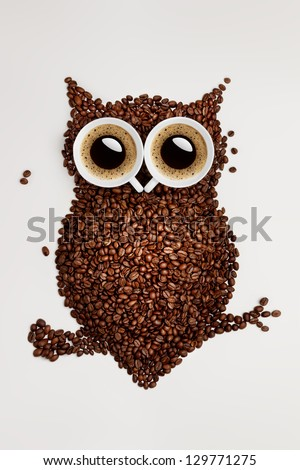 Easy way to the nightlife. A funny owl, made of coffee seeds and two caps on grey background. - stock photo