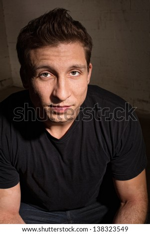 Easygoing white adult male in black shirt - stock photo