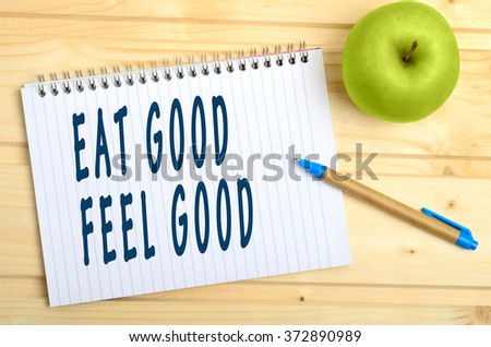 Eat good Feel good words on notebook - stock photo