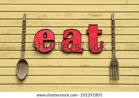 Eat here sign outside of a old town restaurant outside Portland Oregon in the Willamette Valley - stock photo