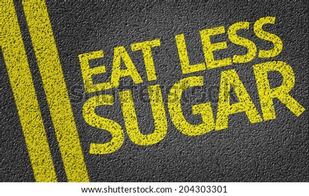 Eat Less Sugar written on the road - stock photo